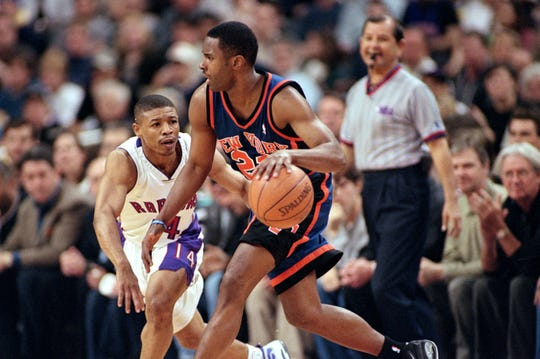 30 Apr 2000:  Charlie Ward #21 of the New York Knicks moves with the ball around Muggsy Bogues #14 of the Toronto Raptors during the NBA Eastern Conference Round One Game at the Air Canada Centre in Toronto, Ontario, Canada. The Knicks defeated the Raptors 87-80.   Mandatory Credit: Rick Stewart  /Allsport