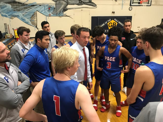 Pace head coach Carl Pippin disciplines his team during a timeout at Gulf Breeze on Thursday.