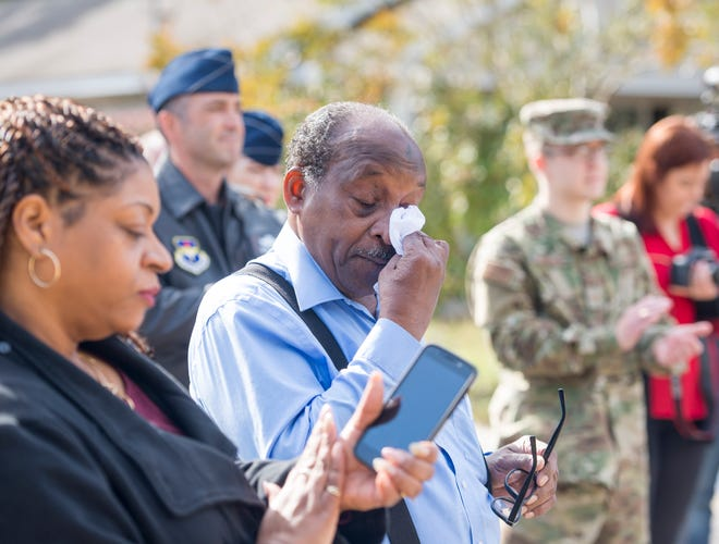 Army veteran Jimmie Perkins wipes tears from his eyes as speakers talk about the home repairs being done to his house during a Pearl Harbor Day Celebration in Pensacola on Friday, December 7, 2018.