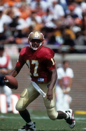 TALLAHASSEE, FL - SEPTEMBER 11:  Quarterback Charlie Ward #17 of the Florida State Seminoles looks to run the ball during an NCAA game against the Clemson Tigers on September 11, 1993 at Doak Campbell Stadium in Tallahassee, Flroida.  The Seminoles defeated the Tigers 57-0.  (Photo by Scott Halleran/Getty Images)