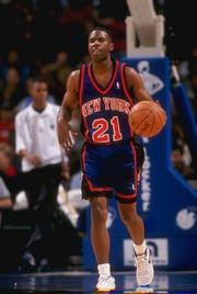 4 Dec 1997:  Guard Charlie Ward of the New York Knicks moves the ball during a game against the Dallas Mavericks at the Reunion Arena in Dallas, Texas.  The Mavericks won the game, 105-91. Mandatory Credit: Stephen Dunn  /Allsport