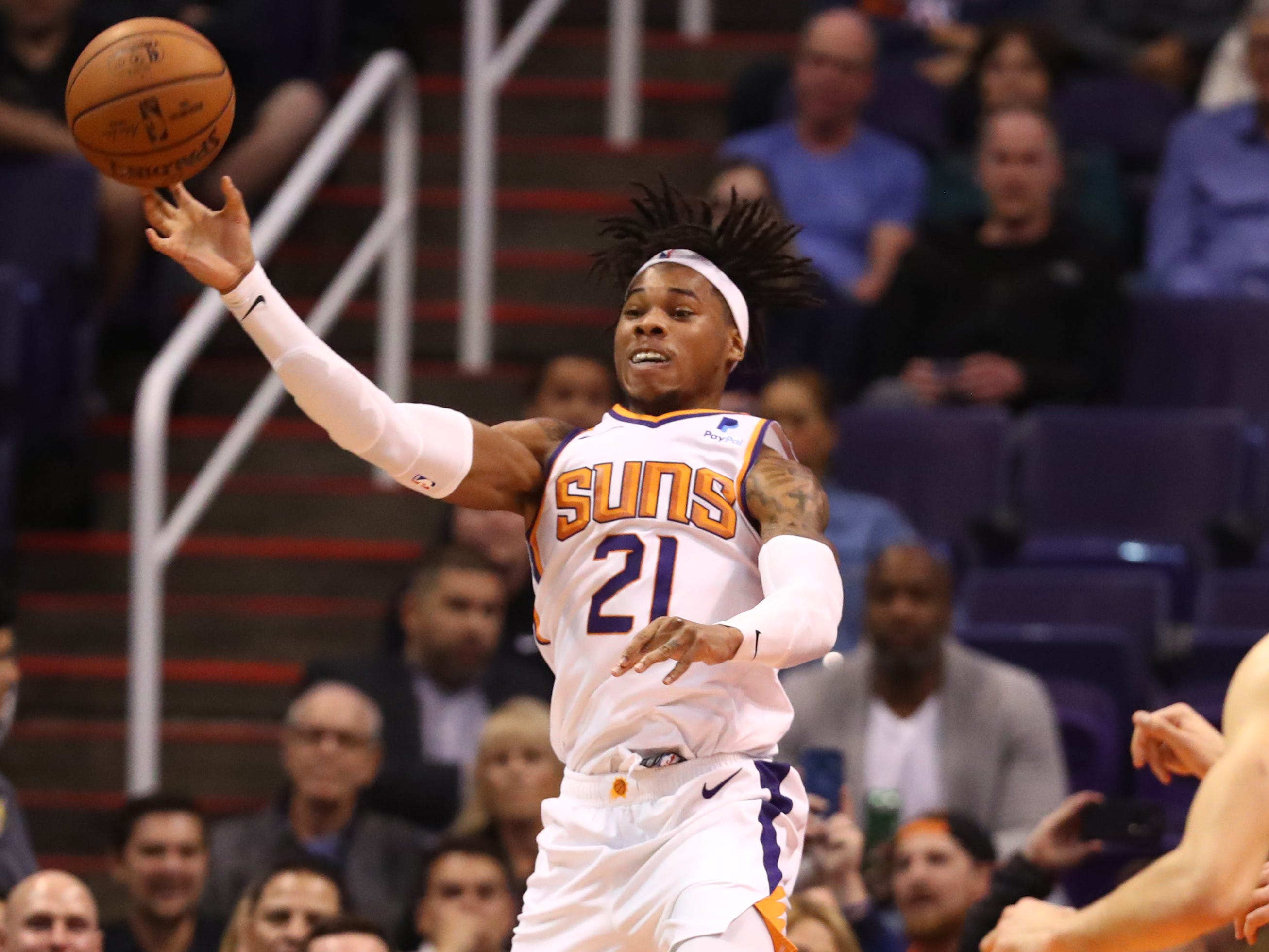 Dec 4, 2018; Phoenix, AZ, USA; Phoenix Suns forward Richaun Holmes (21) passes the ball in the second half against the Sacramento Kings at Talking Stick Resort Arena. Mandatory Credit: Mark J. Rebilas-USA TODAY Sports