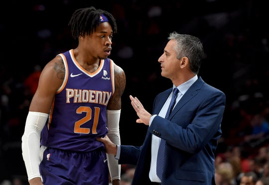 Phoenix Suns forward Richaun Holmes, left, speaks with head coach Igor Kokoskov, right, during the first half of an NBA basketball game against the Portland Trail Blazers in Portland, Ore., Thursday, Dec. 6, 2018. (AP Photo/Steve Dykes)