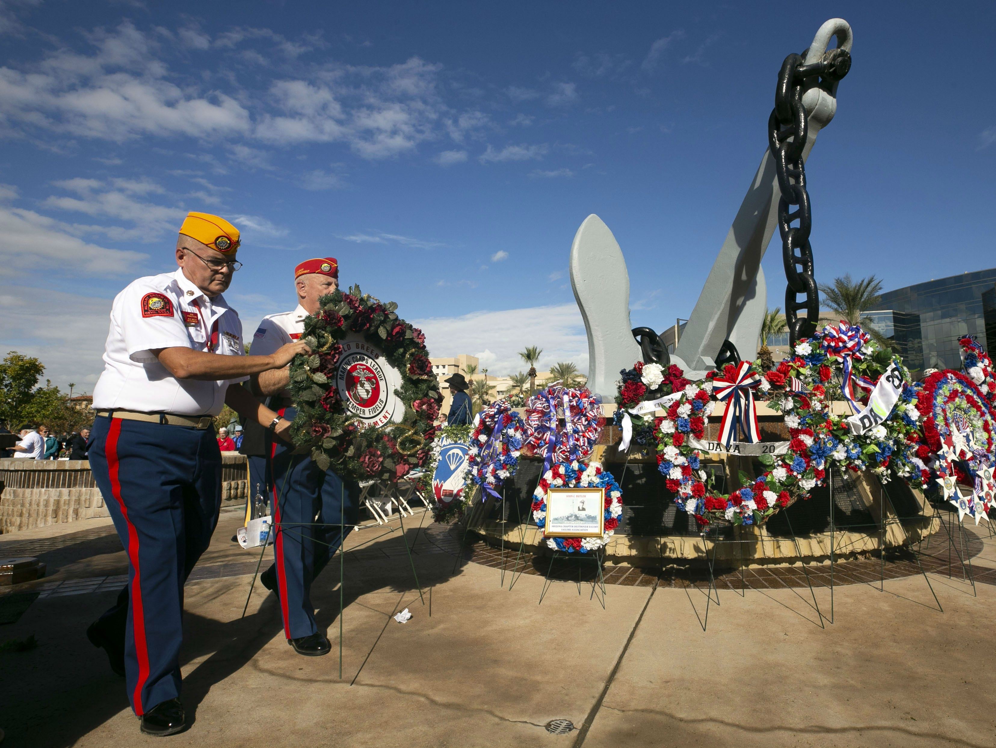 Veterans place memorial wreaths during a Pearl Harbor Remembrance Day event at Wesley Bolin Plaza in Phoenix on Dec. 7, 2018, the 77th anniversary of the attack on Pearl Harbor.