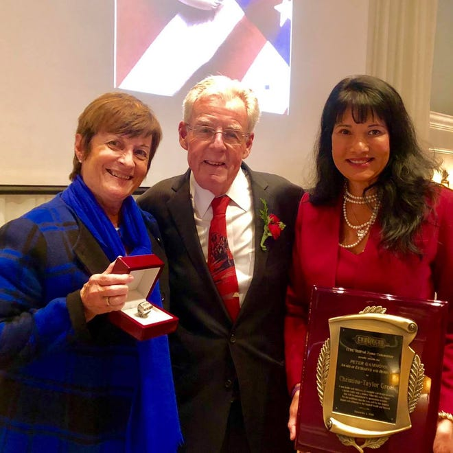 Roxanna Green (right) accepts the Peter Gammons Award for Excellence and Distinction from the Cape Cod Baseball League Hall of Fame, with Gloria and Peter Gammons.