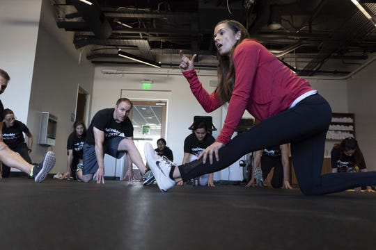 Newly retired Nascar and Indycar driver Danica Patrick works out with GoDaddy employees in Scottsdale on Dec. 7, 2018. Patrick has a long relationship with the Valley company as a spokeswoman.