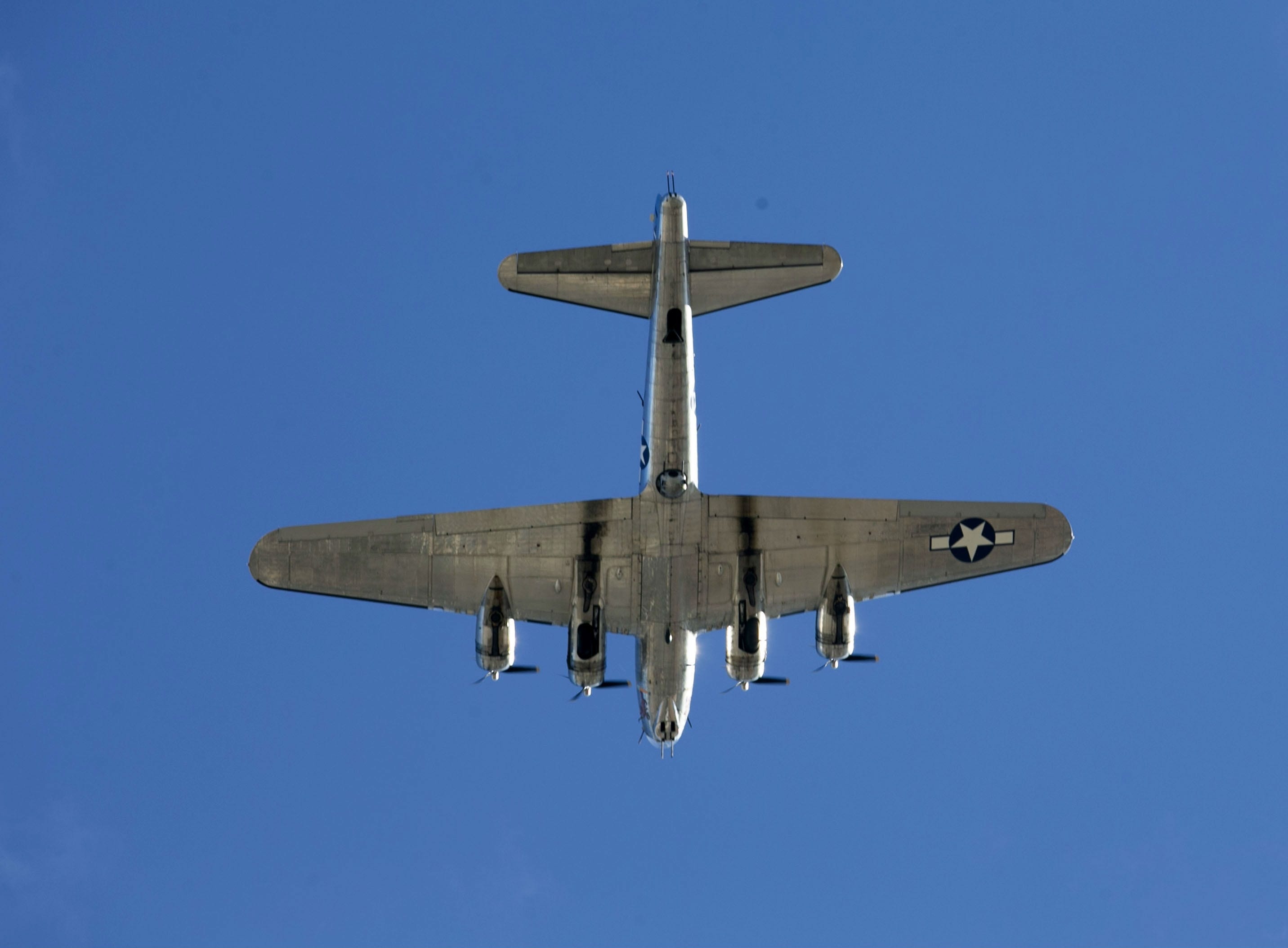 A World War II era B-17 bomber does a flyover during a Pearl Harbor Remembrance Day event at Wesley Bolin Plaza in Phoenix on Dec. 7, 2018, the 77th anniversary of the attack on Pearl Harbor.