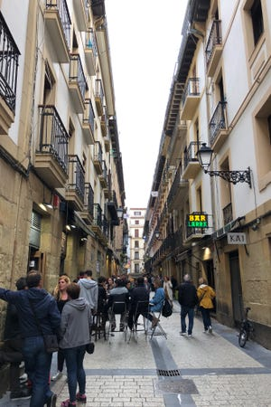 In the evening, people in San Sebastian, Spain, start pintxos crawls, hopping from tavern to tavern in districts like Old Town and having a bite or two.