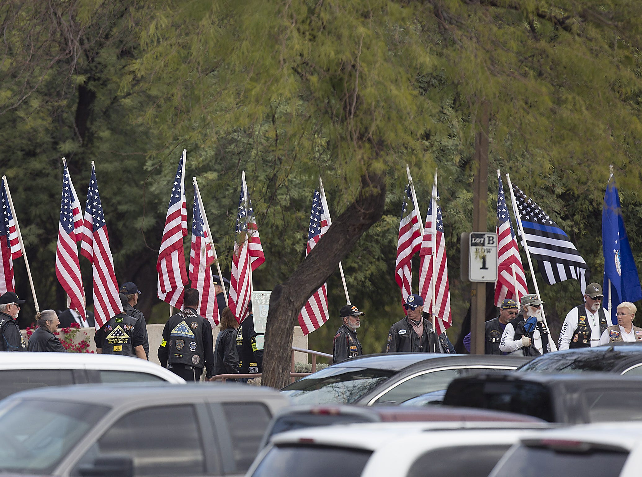 Tucson Police Department officers take part in a procession Dec. 7, 2018, to honor fallen U.S. Marshal Deputy Chase White, who was shot and killed while on duty.
