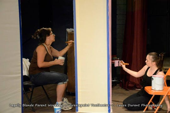 """Painting on the set of Greasepaint Youtheatre's """"Legally Blonde"""" with Savannah Bingham."""