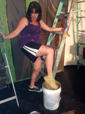 I backed down the 16-foot ladder and stepped — plop! — right into a bucket of muddy brown paint.