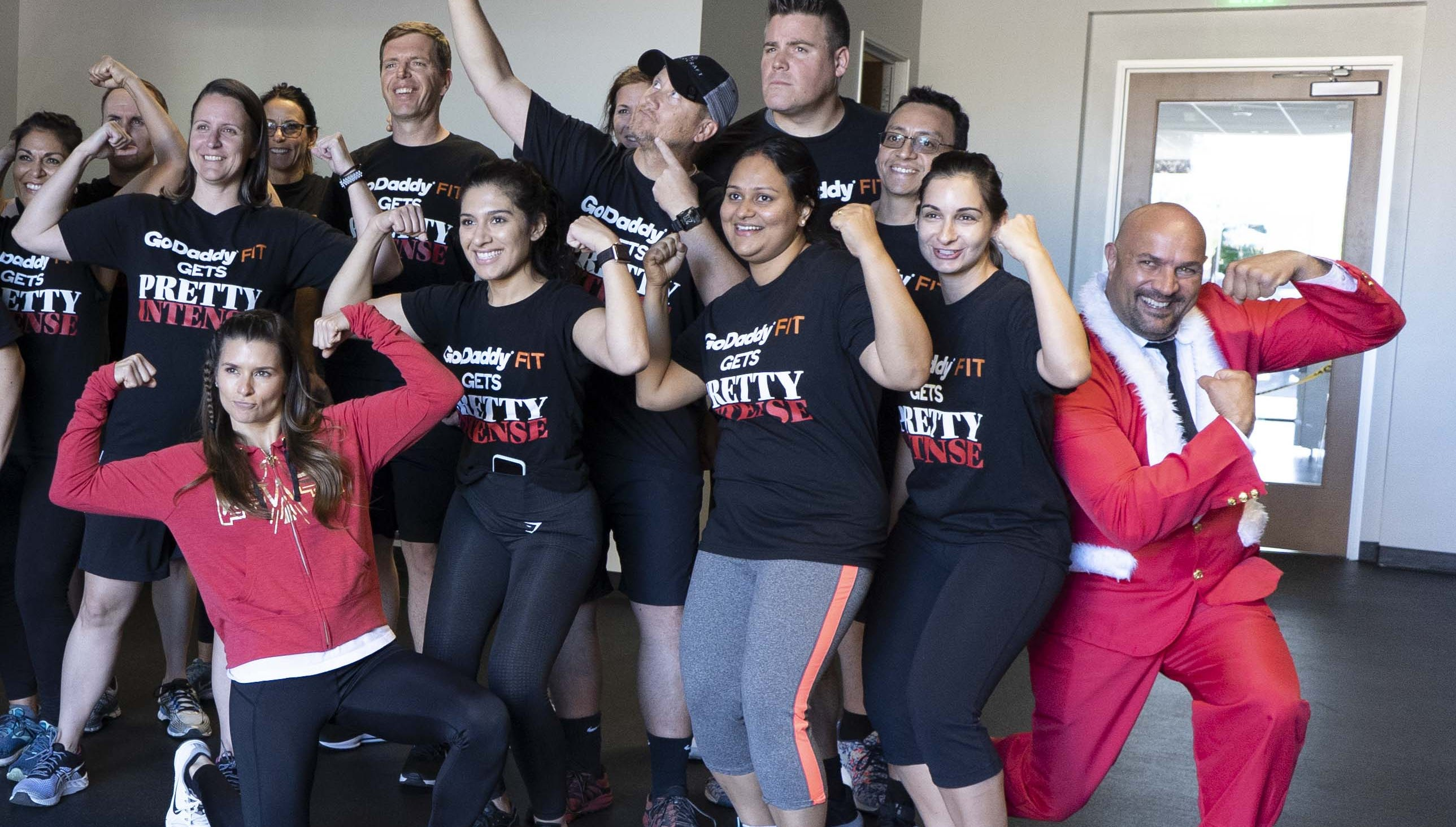 Racing legend Danica Patrick exercises with GoDaddy workers