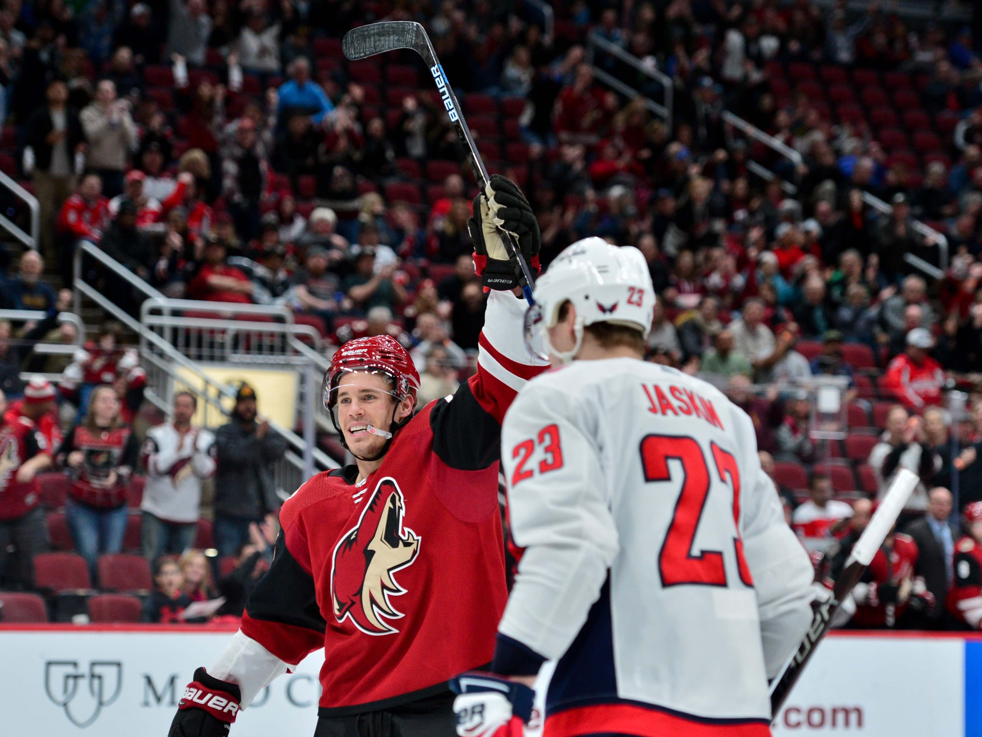 Dec 6, 2018; Glendale, AZ, USA; Arizona Coyotes center Nick Cousins (25) celebrates a goal by Arizona Coyotes left wing Lawson Crouse (not pictured) during the second period against the Washington Capitals at Gila River Arena. Mandatory Credit: Matt Kartozian-USA TODAY Sports