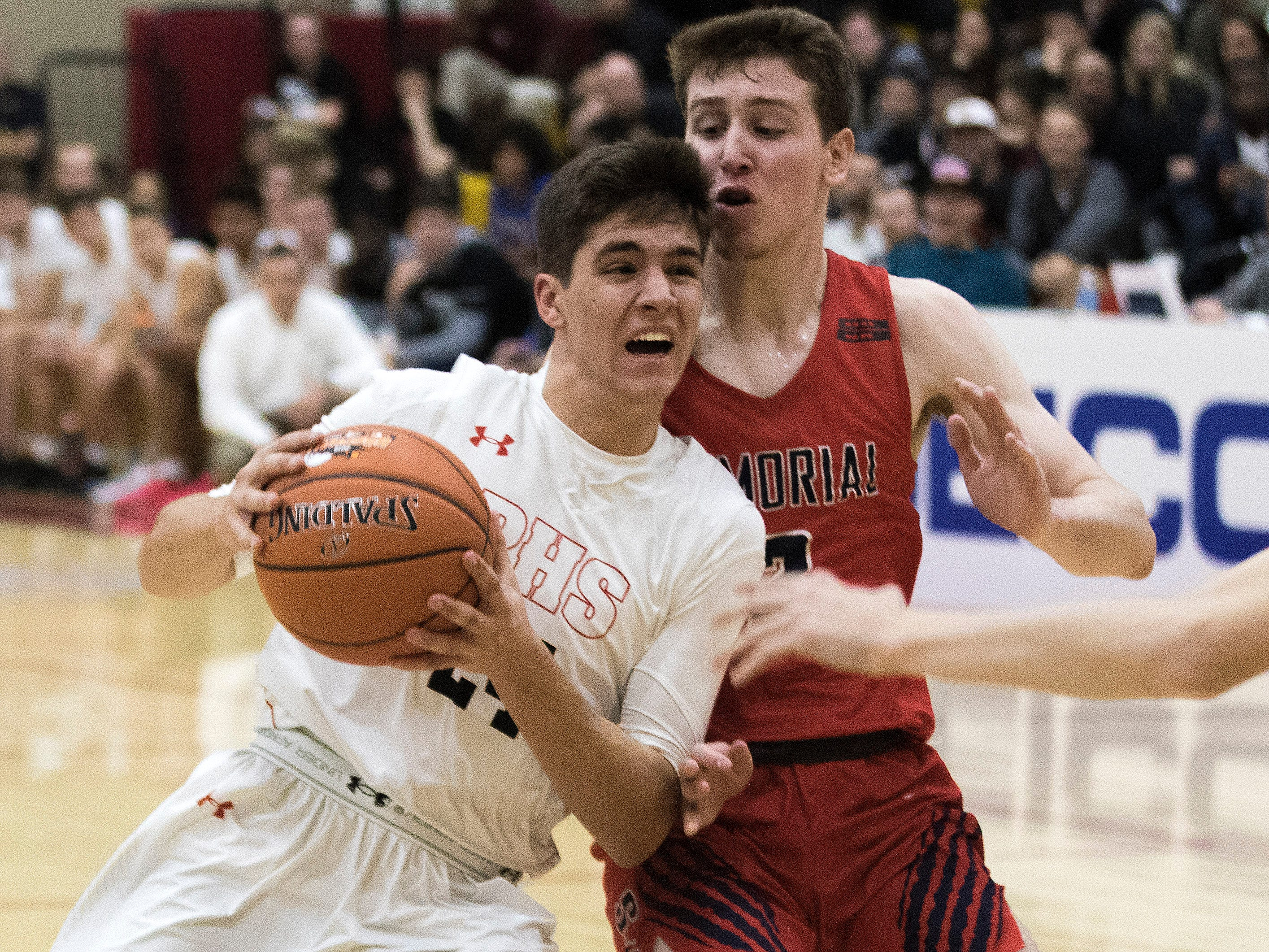 Pinnacle's Trent Brown (24) drives to the basket against San Joaquin Memorial's Kyle Micheli during in the first half of their game in Scottsdale, Thurs, Dec. 6, 2018.