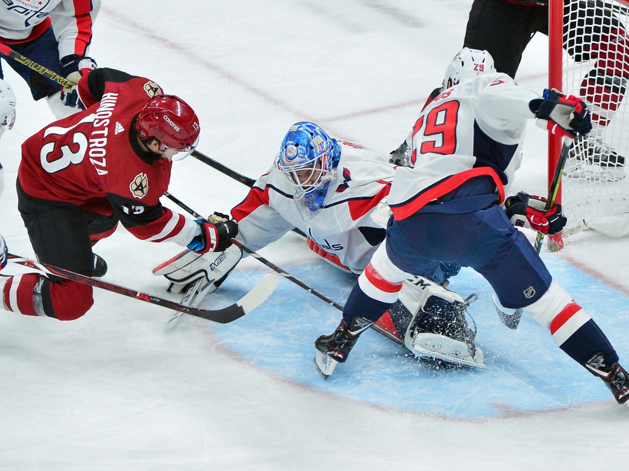 Dec 6, 2018; Glendale, AZ, USA; Washington Capitals left wing Jakub Vrana (13) moves for the puck as Washington Capitals goaltender Pheonix Copley (1) defends during the first period at Gila River Arena. Mandatory Credit: Matt Kartozian-USA TODAY Sports