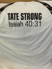 Shirts with 'Tate Strong' worn by members of the Seton Catholic girls basketball team.
