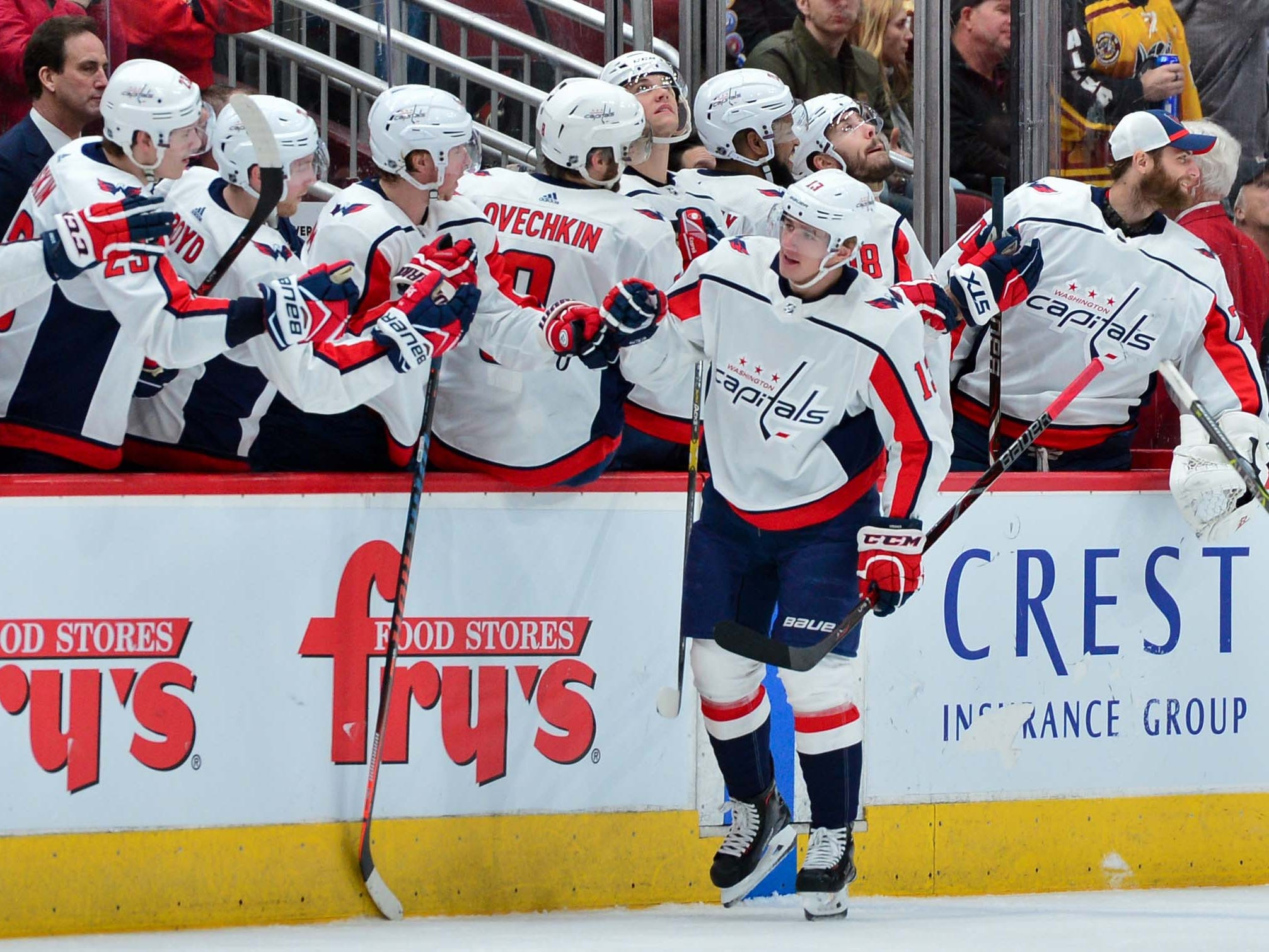 Dec 6, 2018; Glendale, AZ, USA; Washington Capitals left wing Jakub Vrana (13) celebrates with teammates after scoring a goal in the second period against the Arizona Coyotes at Gila River Arena. Mandatory Credit: Matt Kartozian-USA TODAY Sports