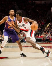 Trail Blazers forward Al-Farouq Aminu drives to the basket against Suns rookie forward Mikal Bridges during the second half of a game Dec. 6 at the Moda Center.