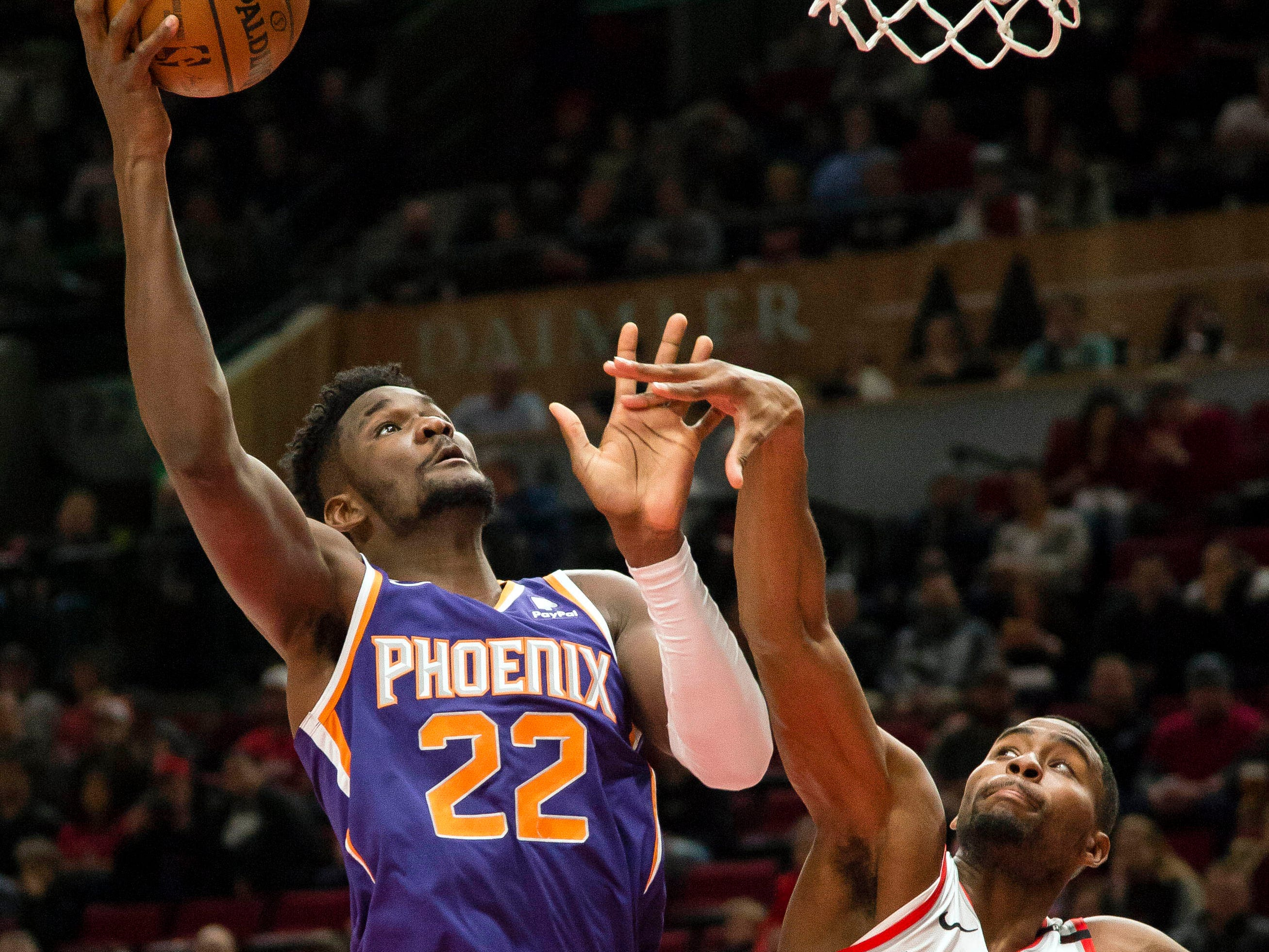 Dec 6, 2018; Portland, OR, USA; Phoenix Suns center Deandre Ayton (22) shoots over Portland Trail Blazers forward Maurice Harkless (4) during the first half at Moda Center. Mandatory Credit: Troy Wayrynen-USA TODAY Sports