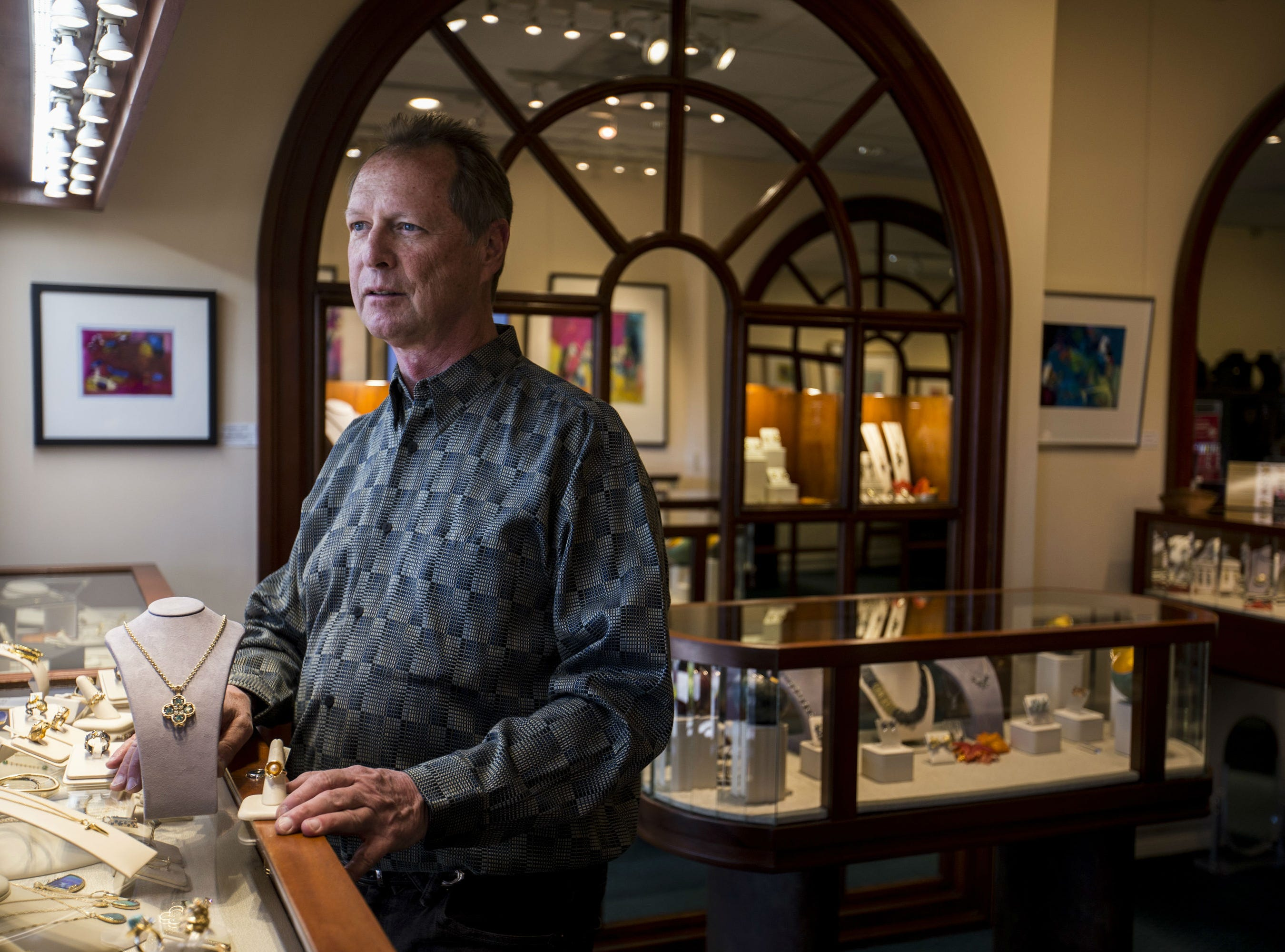 French Thompson poses for a portrait on Nov. 19, 2018, at French Designer Jeweler in Scottsdale. His store features custom jewelry and art from artists around the world.