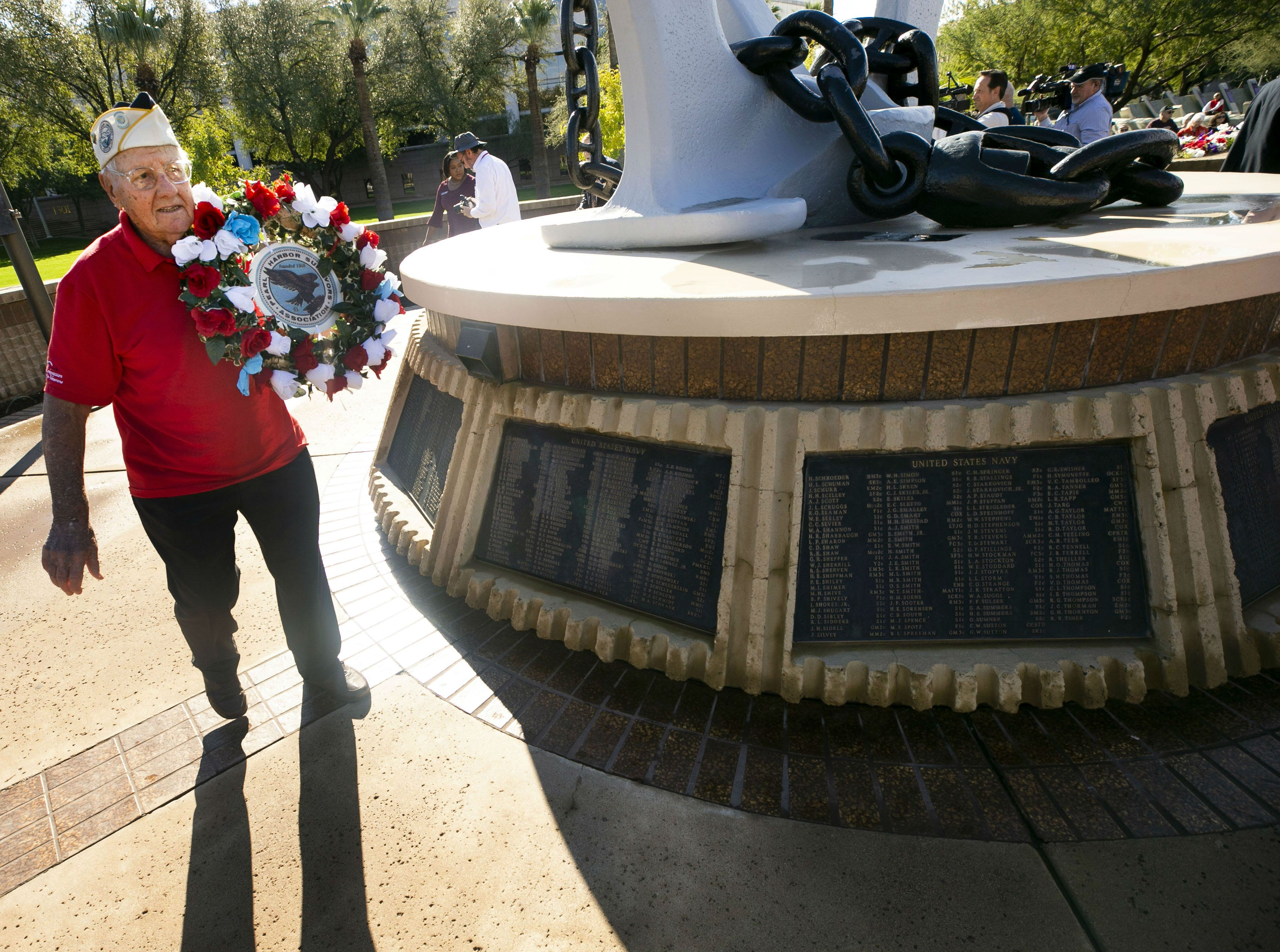Pearl Harbor survivor Edward Miklavcic, a Phoenix veteran of the then-U.S. Army Air Forces, places a memorial wreath during a Pearl Harbor Remembrance Day event at Wesley Bolin Plaza in Phoenix on Dec. 7, 2018, the 77th anniversary of the attack on Pearl Harbor.