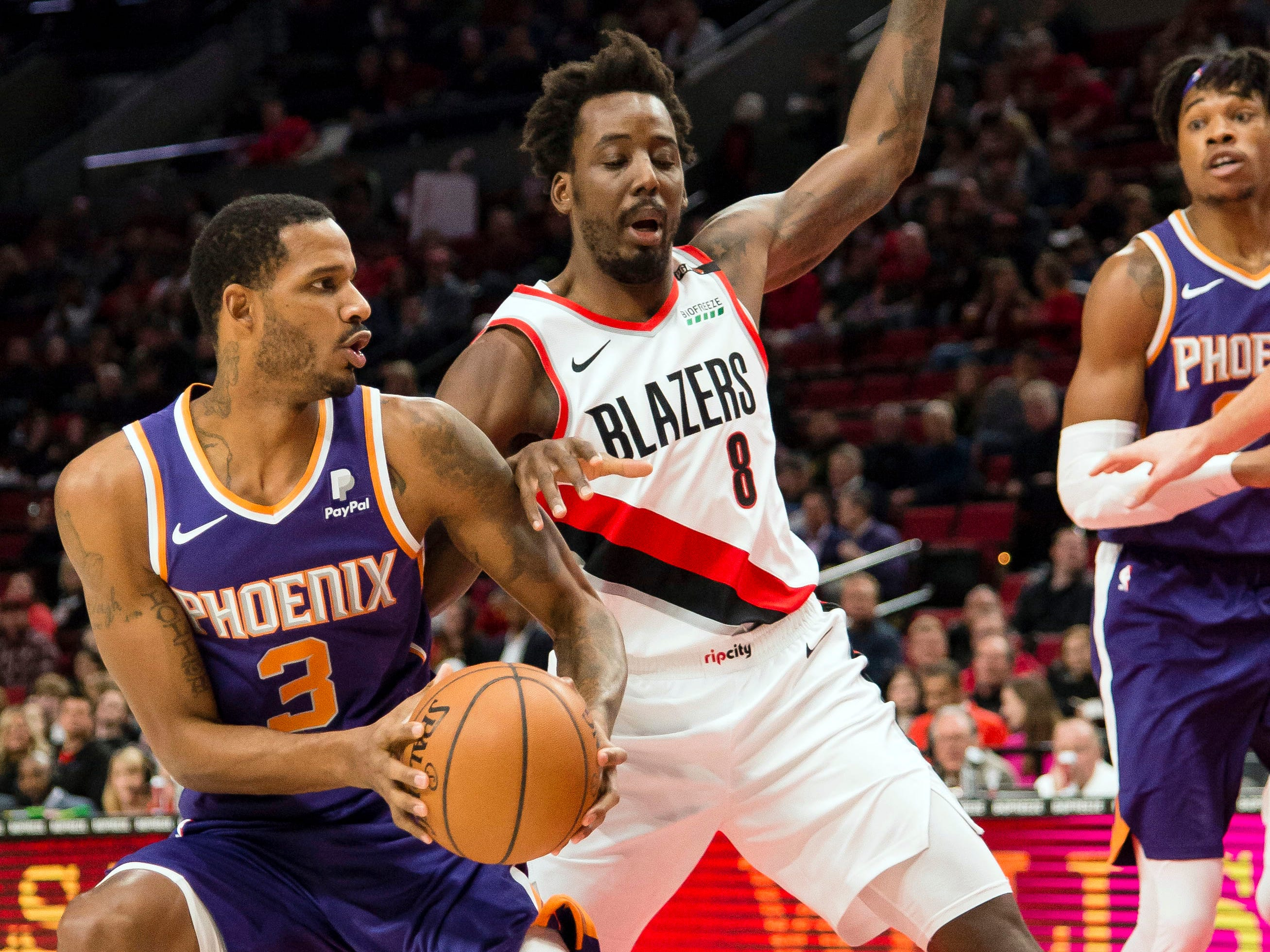 Dec 6, 2018; Portland, OR, USA; Phoenix Suns forward Trevor Ariza (3) stops to shoot a basket against Portland Trail Blazers forward Al-Farouq Aminu (8) during the first half at Moda Center. Mandatory Credit: Troy Wayrynen-USA TODAY Sports