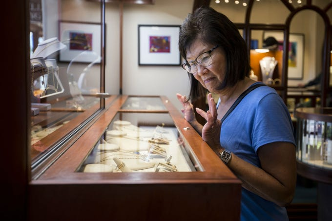 Marianne Robinson looks at jewelry on Nov. 19, 2018. at French Designer Jeweler in Scottsdale. The store features custom jewelry and art from artists around the world.