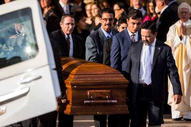 Pallbearers carry Congressman Ed Pastor's casket after his funeral on Dec. 7, 2018, at St. Francis Xavier Catholic Church in Phoenix.