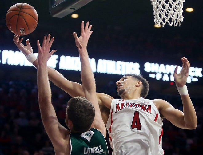 Dec. 6, 2018; Arizona Wildcats forward Chase Jeter (4) goes up for a rebound against Utah Valley  Wolverines forward Wyatt Lowell during the first half at McKale Center in Tucson, Ariz.