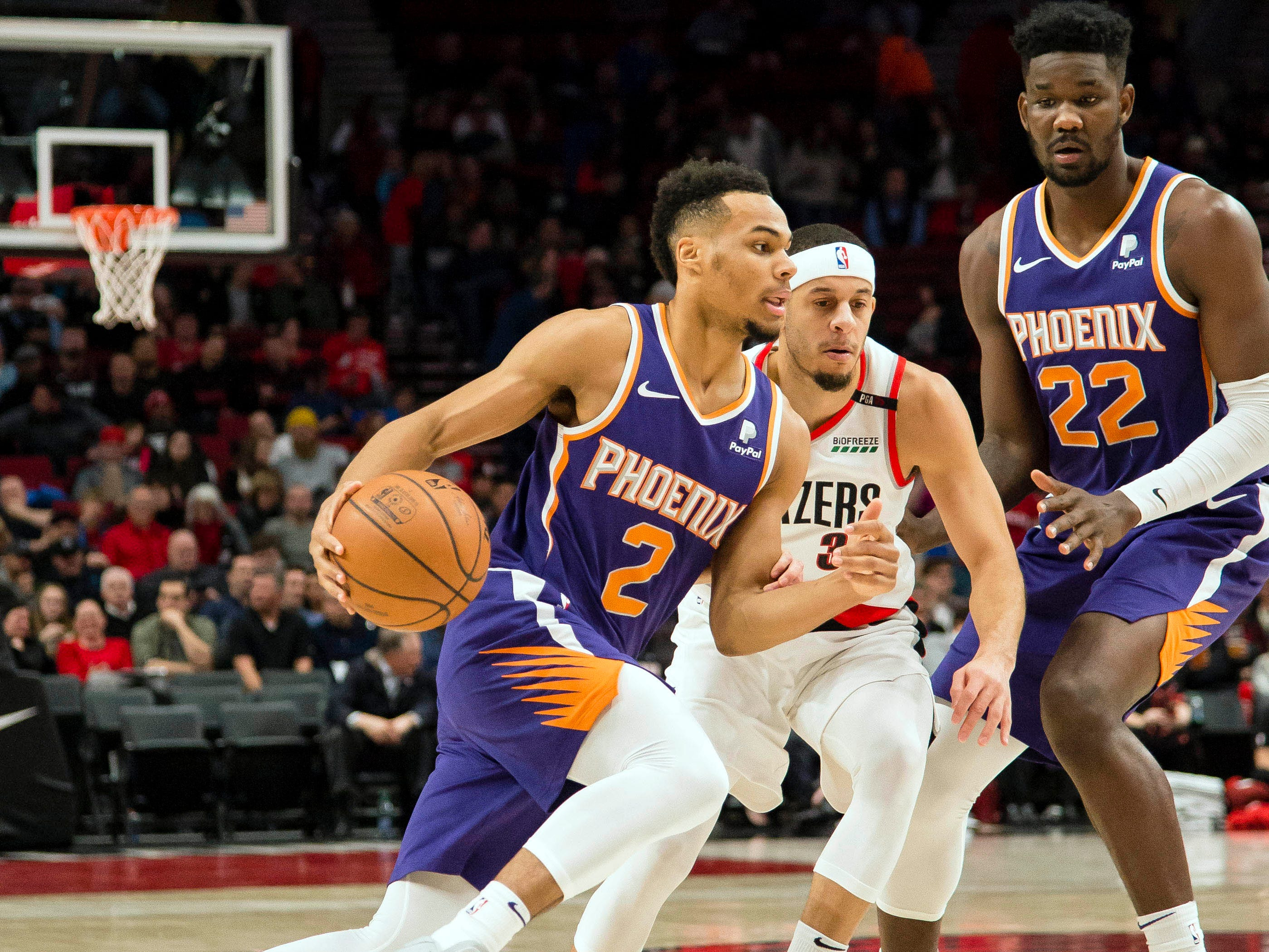 Dec 6, 2018; Portland, OR, USA; Phoenix Suns guard Elie Okobo (2) drives to the basket against Portland Trail Blazers guard Seth Curry (31) during the first half at Moda Center. Mandatory Credit: Troy Wayrynen-USA TODAY Sports