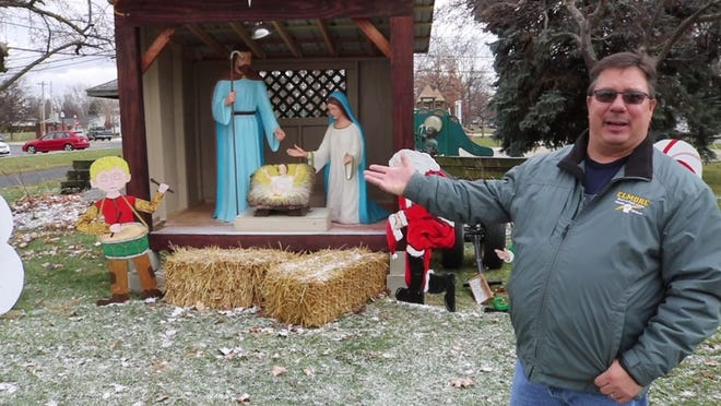 Mayor Matt Damschoder points out the additional items the Village of Elmore added to its Nativity display so it could return to Walter Ory Park after being threatened with a lawsuit by the Freedom From Religion Foundation last year.