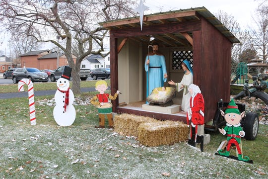"""After being threatened with a lawsuit last year, the Village of Elmore's nativity scene is back on public property at Walter Ory Park, but with added secular elements such as Santa Claus, an elf, a snowman, candy canes and """"The Little Drummer Boy."""""""