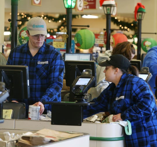 From left, front end supervisor Brian Owen and front end supervisor Megan Gonzalez bag a customer's groceries at Adams Fairacre Farms in the Town of Wappinger on December 7, 2018.