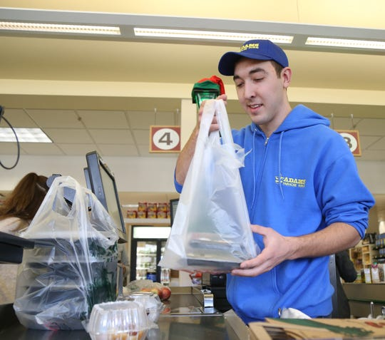 Cashier Ricky Fusaro bags a customer's groceries at Adams Fairacre Farms in the Town of Wappinger on December 7, 2018.