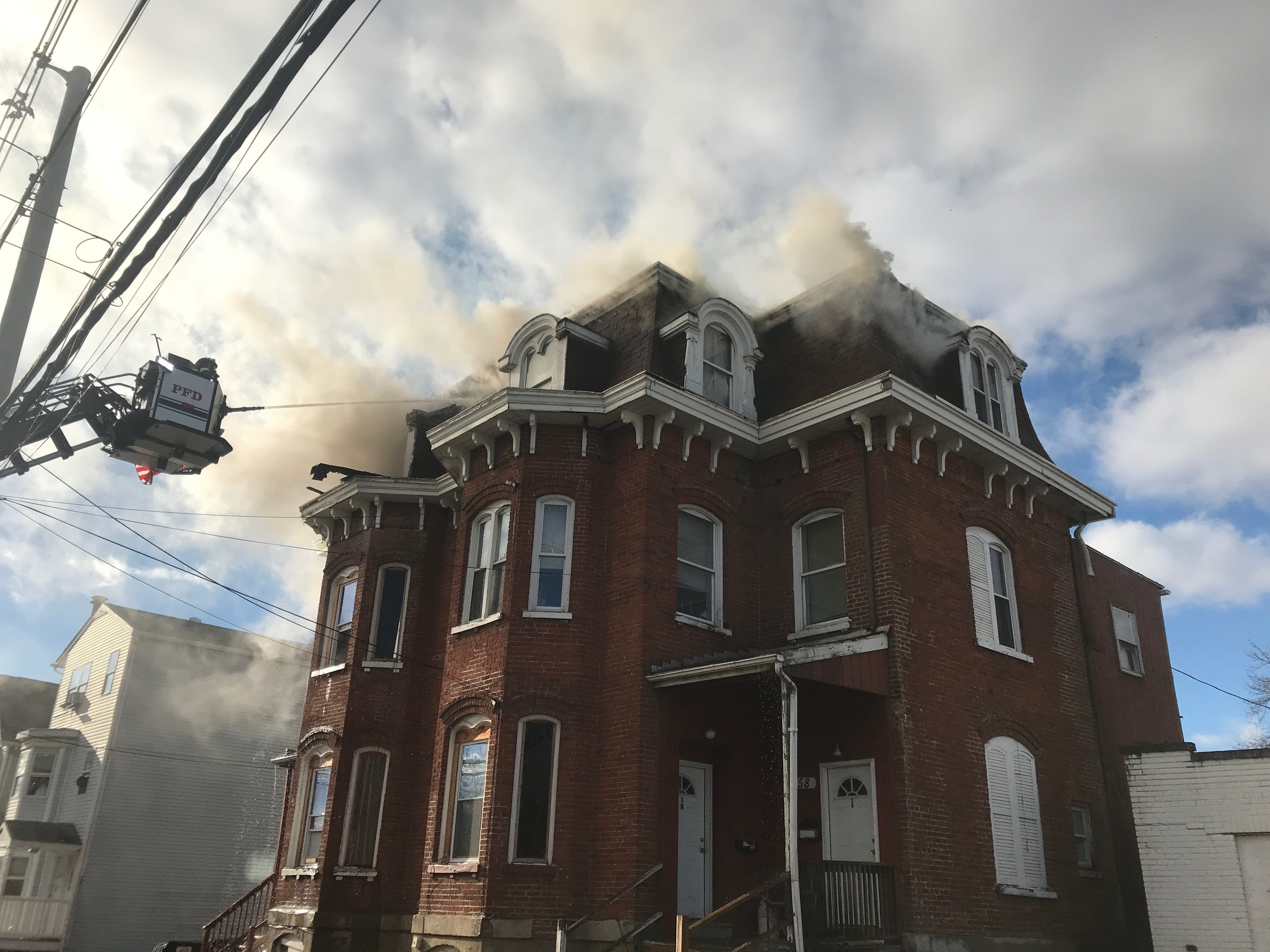 Multiple agencies responded to a structure fire on Smith Street in the City of Poughkeepsie Friday.