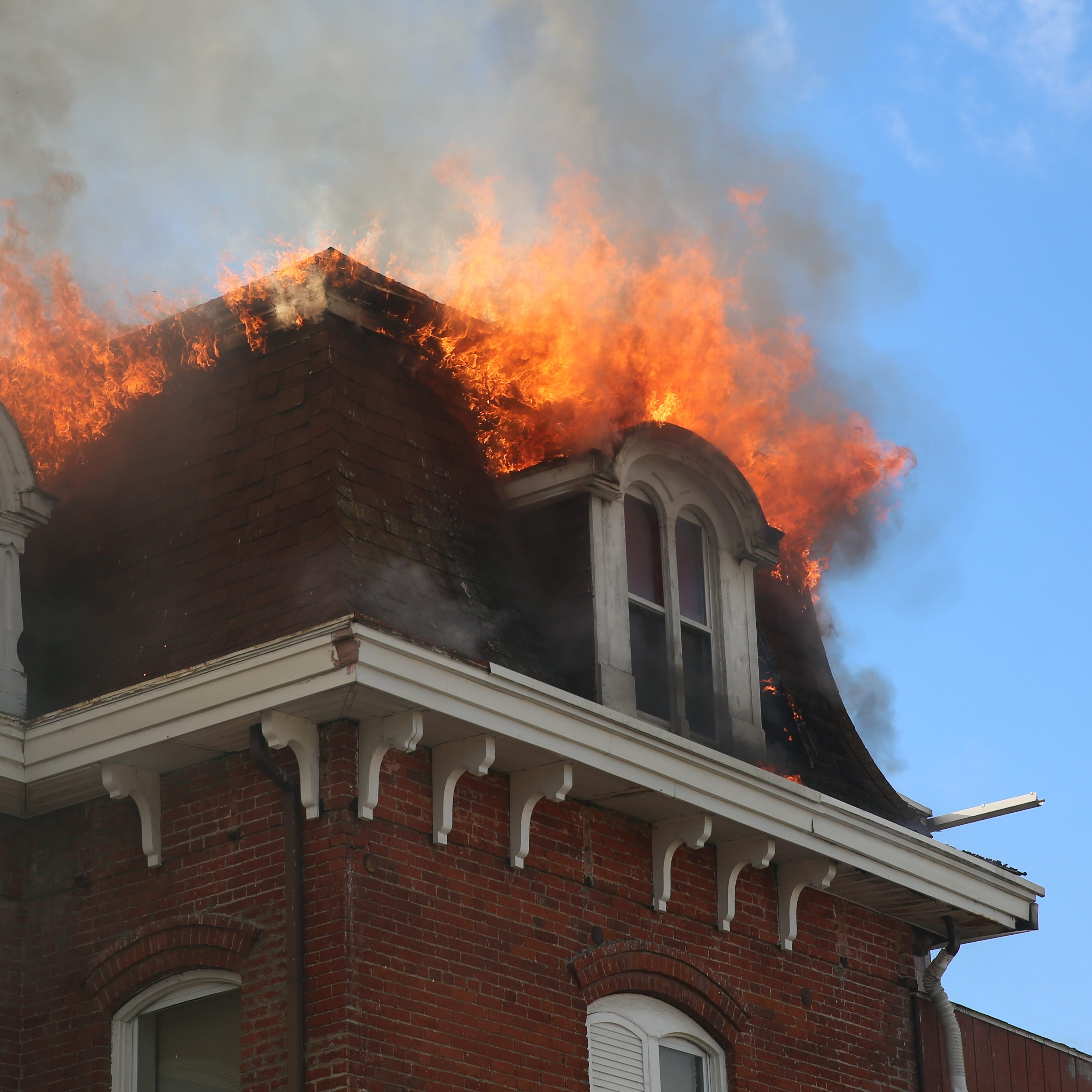 Firefighters respond to a fire on Smith Street in the City of Poughkeepsie on Friday.