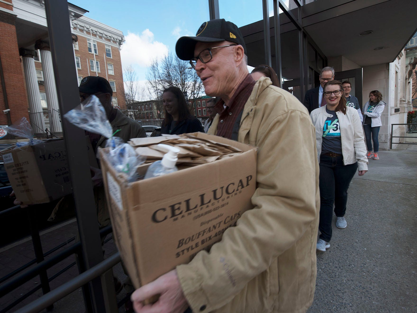 Franklin County Commissioner Bob Thomas carries a care box. The 11/30 Network is hosting its annual First Responders Appreciation Day on Friday, December 7, 2018. The steering committee visited the Franklin County Sheriff's office and over 35 other first responder stations to deliver care packages.