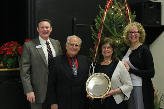 Jim Martin, president of Martin's Famous Pastry Shoppe, was named Greater Chambersburg Chamber of Commerce's Business Person of the Year. Pictured are, from left: Steve Christian, chamber president; Jim and Donna Martin; and Kim Crider, chair of the chamber board.