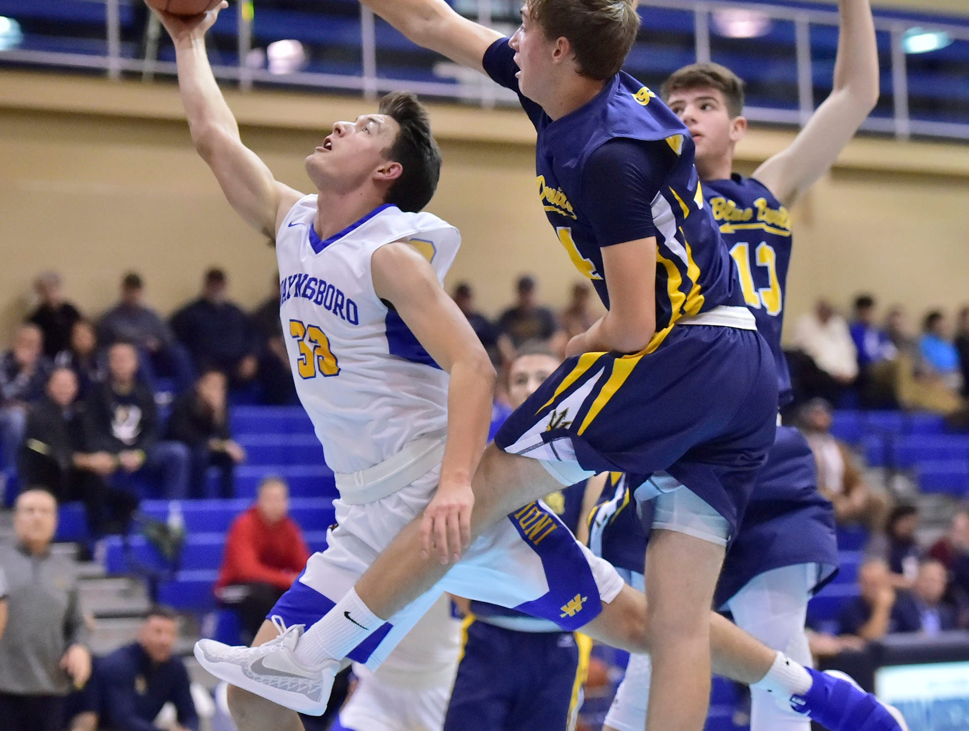 Waynesboro's Hunter Clever (33)  shoots over Greencastle defenders during the Franklin County Tip-Off Tournament, Friday, Dec. 7, 2018.