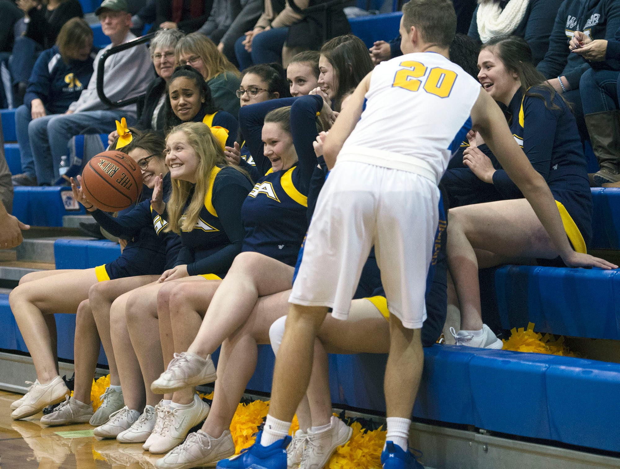 Waynesboro's Aidan Campbell chases the ball as Greencastle cheerleaders react during the Franklin County Tip-Off Tournament, Friday, Dec. 7, 2018.