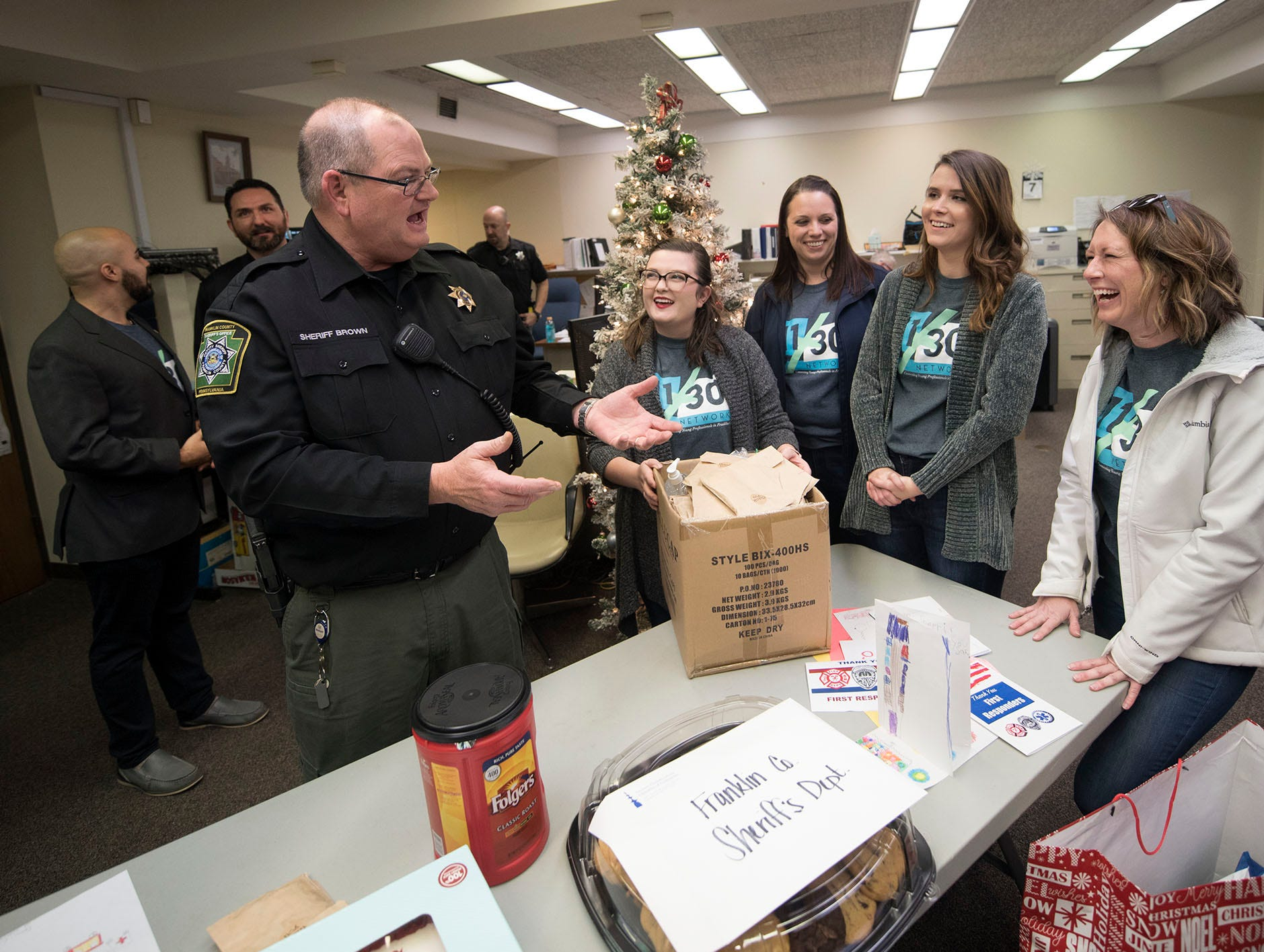 Sheriff Jim Brown, left, greets 11/30 member Logan Peters, Sara Ziegler, Lacey Kipe and Tracy Ross. The 11/30 Network is hosting its annual First Responders Appreciation Day on Friday, December 7, 2018. The steering committee visited the Franklin County Sheriff's office and over 35 other first responder stations to deliver care packages.