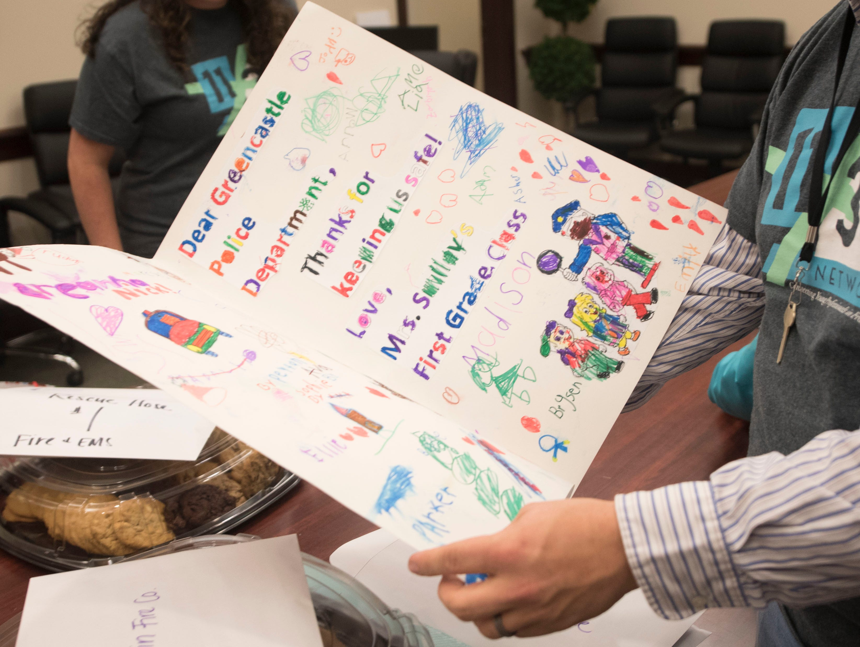 Sam Thrush looks through one of the thank you cards from Greencastle-Antrim students. The 11/30 Network is hosting its annual First Responders Appreciation Day on Friday, December 7, 2018. The steering committee visited the Franklin County Sheriff's office and over 35 other first responder stations to deliver care packages.