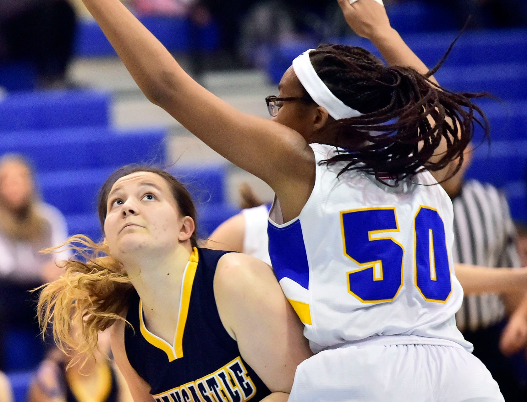 Greencastle's Madison Sweitzer (24) tries to shoot over Waynesboro's Sophia Johnsonj during the Franklin County Tip-Off Tournament, Friday, Dec. 7, 2018.