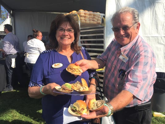 Jim With His Wife Donna Serving Sandwiches With Martins Potato Rolls