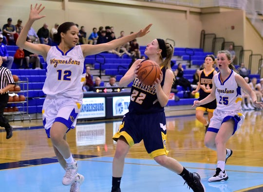 Greencastle's Lydia Crist (22) tries to shoot over Waynesboro's Tatianna Badger (12) during the Franklin County Tip-Off Tournament, Friday, Dec. 7, 2018.