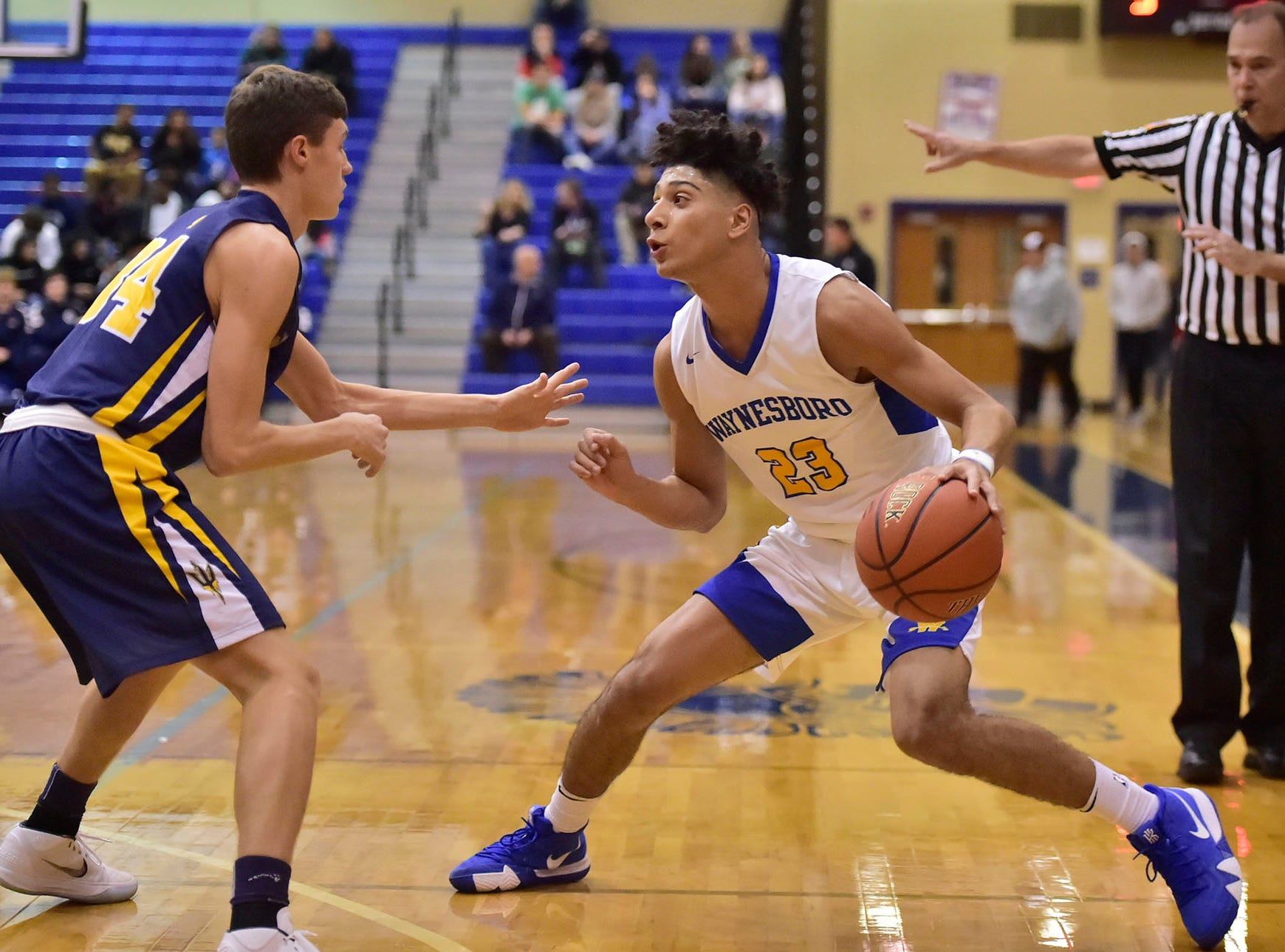 Waynesboro (23) Jay Alvarez works the ball against Greencastle's Nicholas Ehko  during the Franklin County Tip-Off Tournament, Friday, Dec. 7, 2018.