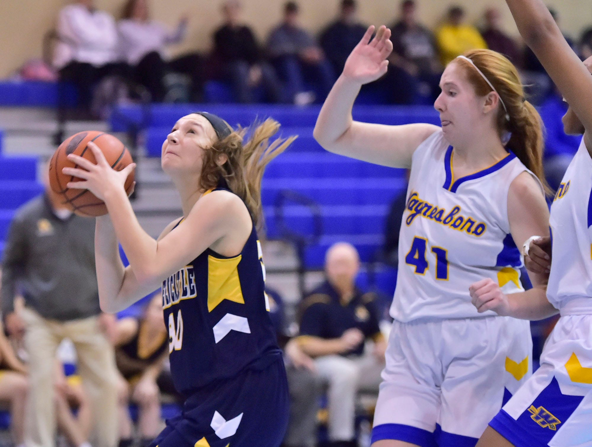 Greencastle's Lauren Pool (30) shoots past Waynesboro's Abby Sheasley (41) during the Franklin County Tip-Off Tournament, Friday, Dec. 7, 2018.