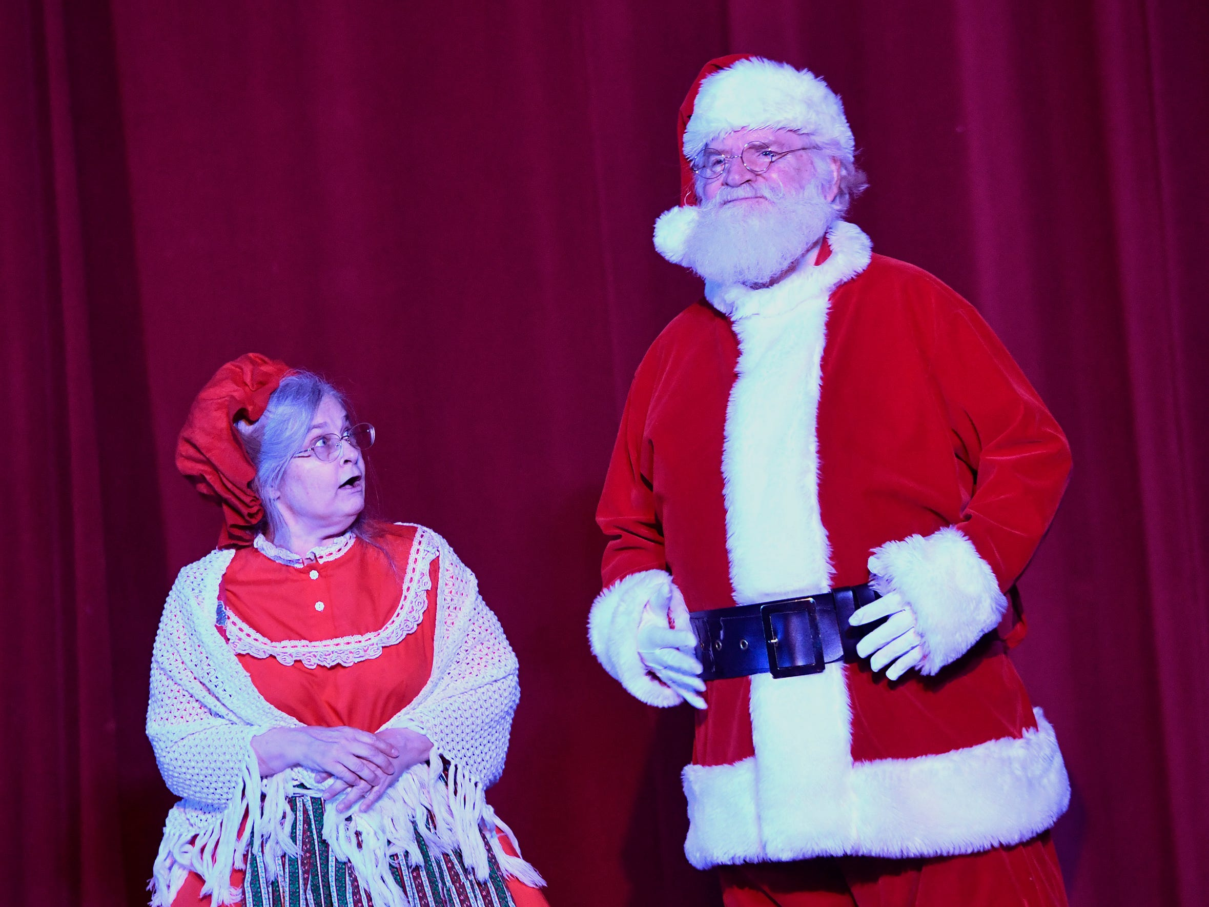 """Mrs. Claus, left, played by Sarah Kilgalen, and Santa, played by Steve Brown, prepare for Santa's Christmas Eve adventure during a dress rehearsal for the Theater Arts for Everyone performance of """"The Night Before Christmas."""" Show times are Dec. 7 and 8 at 7 p.m. and Dec 8 and 9 at 3 p.m.  at the York Learning Center. Tickets are available at the door or through Eventbrite. Thursday, December 6, 2018.  John A. Pavoncello photo"""