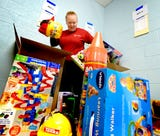 Giant Food Stores provided several employees to work at area Salvation Army locations. In York, this team helped sort toys for the annual Christmas distribution.