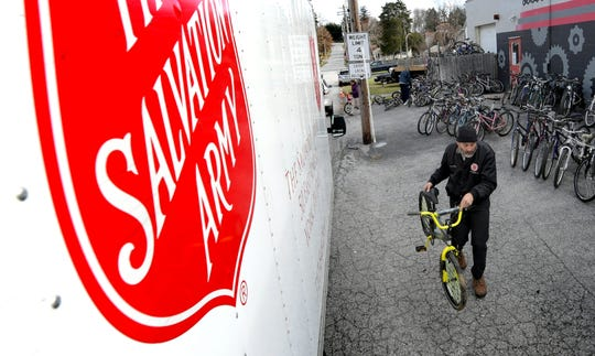 Salvation Army employee Harold Borror loads an item Friday, Dec. 7, 2018, at Gung Ho Bikes to include in the Salvation Army Christmas Cheer Distribution. The bike shop refurbishes bikes collected throughout the year and offers them to charitable organizations for the holidays. The Salvation Army food and toy distribution takes place Dec. 18 and 19 from 10 a.m. to 4 p.m. both days. About 1,300 families have registered for food pickup and 1,000 are signed up to receive toys. Bill Kalina photo